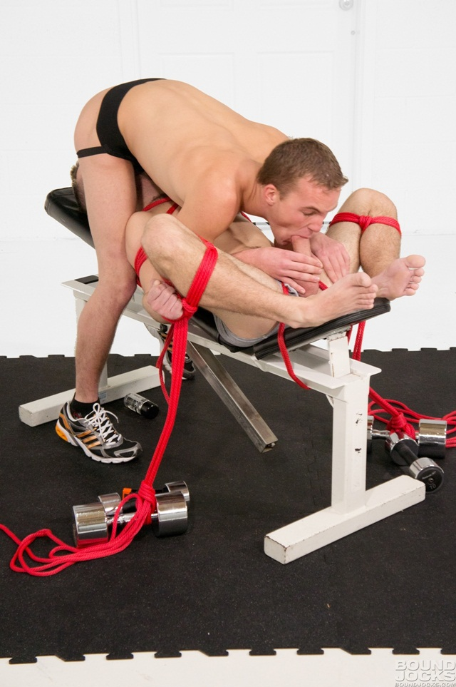 Hayden Michaels tied down to a weight bench his knees spread wide open and mouth gagged with Blonde haired Alex Andrews Download Full Stud Gay Porn Movies Here