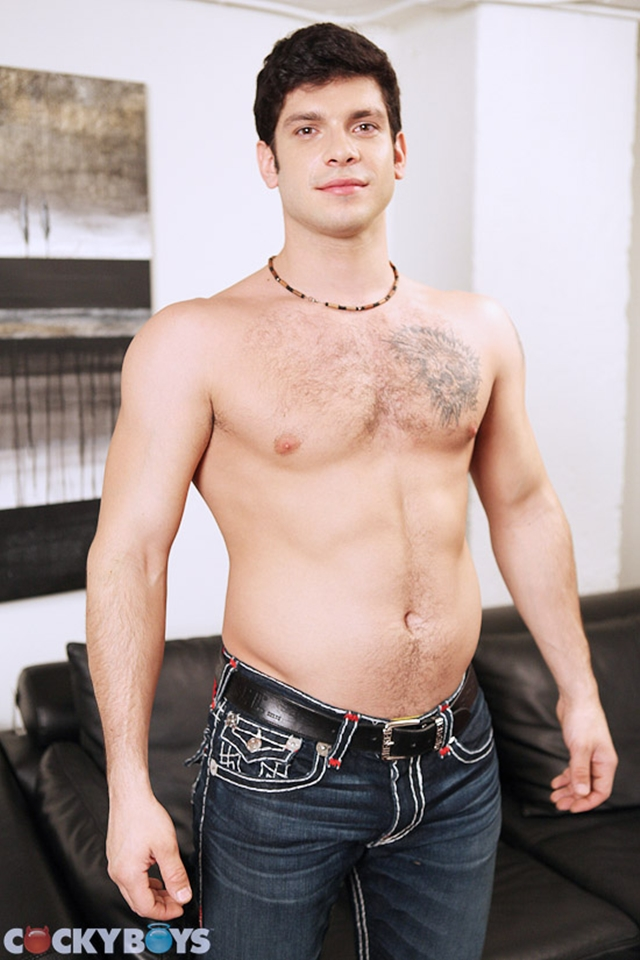 Hairy chested tattooed dude Derek Strong at Cockyboys