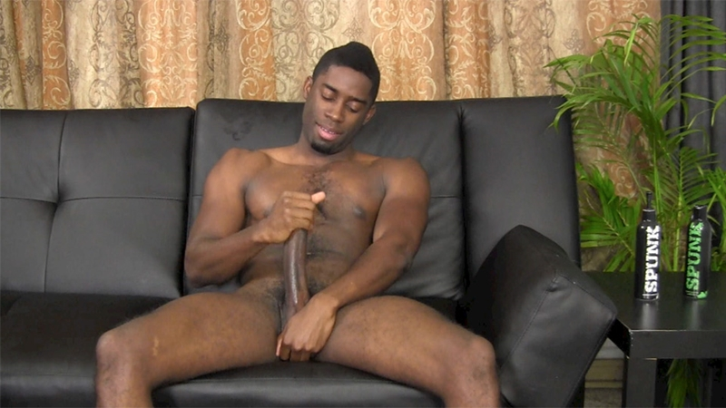 Tyler wanks his 10 inch black cock to a huge jizz shower